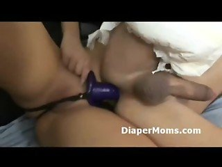 Kinky slut with strapon rams diaper wearing boys ass while wanking his baby dick