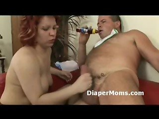 Redhead mature lady strapon fucks diaper wearing boy then gives him handjob