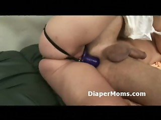 Old bitch strap-on fucks diaper wearing boy while he sucks his pacifier