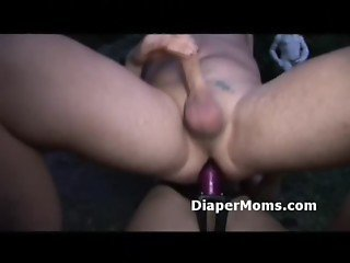 Skinny blonde makes diaper boy ride her strap-on then gives him handjob
