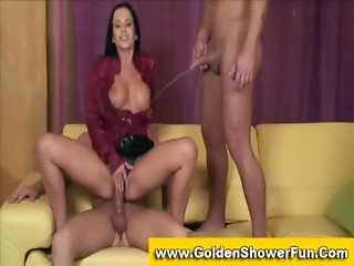 Dressy brunette pissed on while fucking