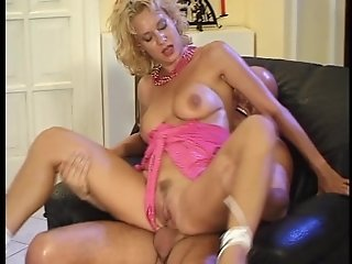 Horny housewife fucks a bald guy on a chair