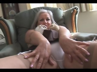 Attractive busty granny in stockings stripping