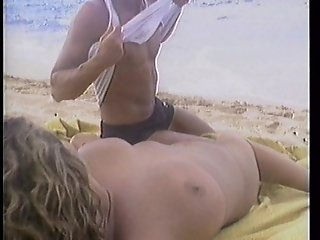 Young stud gets lucky with hot blonde on the beach.