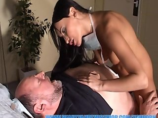 Hot nurse is helping an old patient