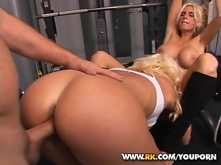 Two sexy blondes working out wildly in the gym