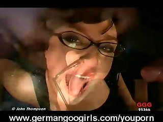 Brunette with glasses swallows cum