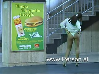 Italian woman strips at train station