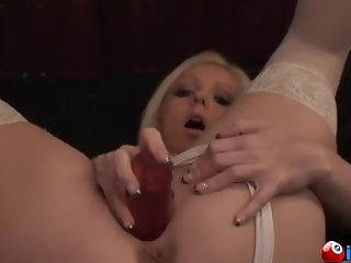 Blond with big tits fucks herself