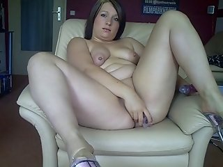 Chubby German girl fucks her ass and pussy with dildos
