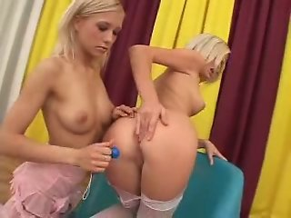 Two girls use anal beads