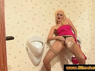 Skanky blonde at an interracial gloryhole