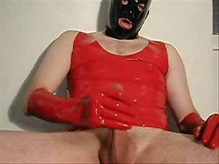 A cock, red latex gloves and the result