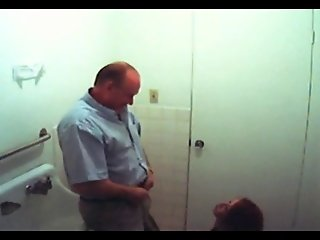 Fake spy redhead gives old man head in bathroom