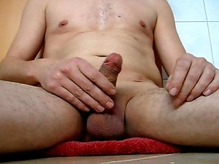 Playing with my shaved and oiled cock