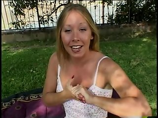 Sexy blonde giving a handjob outdoors