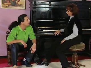 Hot piano teacher fucks