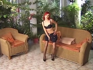 Petite sexy redhead dped in stockings and panties