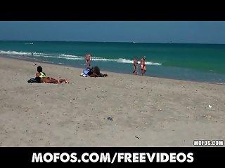 Nikki Chase is picked up while tanning on the beach for anal