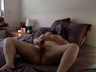 German BBW masturbates on bed