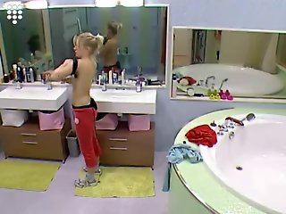 Big Brother NL Hot Blond Girl putting sportbra on to sport