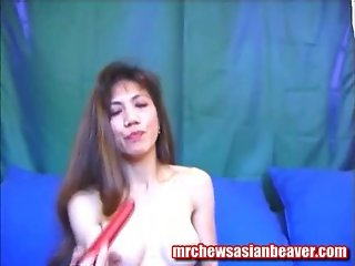 Oriental Babe And Her Red Sextoy