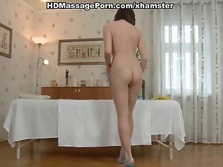 Young brunette sucks and fucked on a massage
