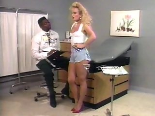 Big hair blonde gets fucked from behind in doctor's office