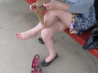 Girl put on stockings on bus stop