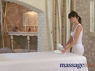 Massage Rooms Rita oils up her huge juicy breasts on a cock