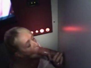 WHITE LADY ON HER KNEES SUCKING AND LICKING BLACK DICK