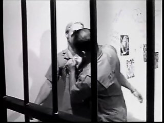 Guy with long blond hair in prison
