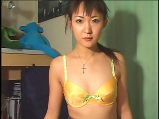 Petite little Asian takes top off and rubs vibrator on her clit