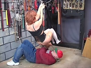 Sexy mature redhead gets her pussy toyed then gets abused in the dungeon
