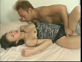 Japanese nympho with tight pink pussy gets licked and fucked on bed