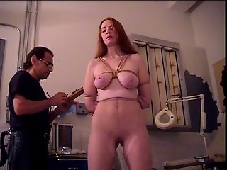 Redhead with big naturals bound and has her pussy teased