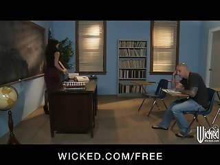 Strict brunette teacher gives punishes her student in class