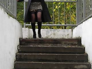 Girl in miniskirt and stockings going downstairs