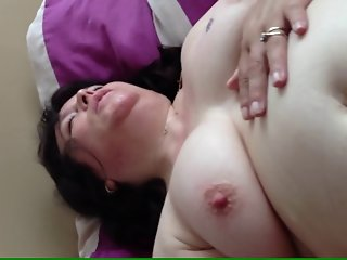 Horny granny in bed