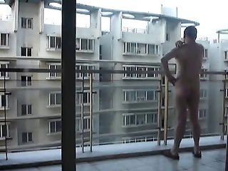 Nudist On Balcony in Public