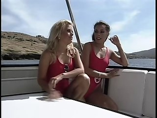 Lifeguard babes having lesbian fun on a boat