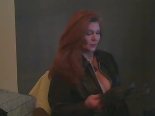 Hot Mature in Leather Smoking 120s and Teasing