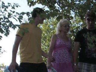 Naughty old cunt fucks two young guys at once