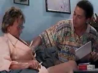 Young doctor touching a 57 years old granny
