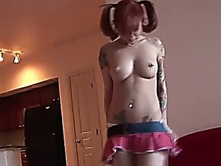 Tattooed And Busty Emo Bitch Strips And Dances On The Couch