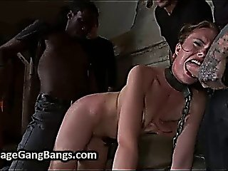 Chained Brunette Orgy Fucked In Basement