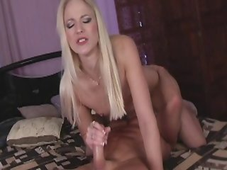 Spunky Blonde Babe Stroking A Hard Cock Until It Jizzes Her