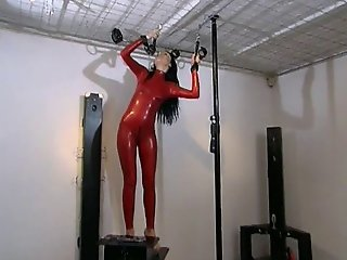 Russian Babe In Red Latex Bodysuit Plays With Self Bondage