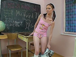Teen Schoolgirl Masturbates With A Dildo In The Classroom