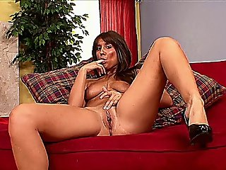 Sexy Babe Masturbating On The Couch In Solo Scene